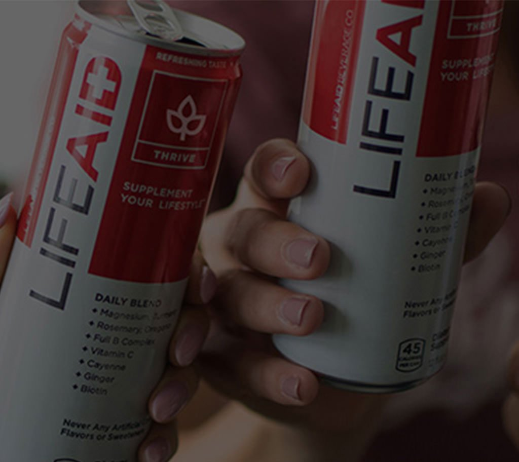 background image of hands holding LIFEAID cans