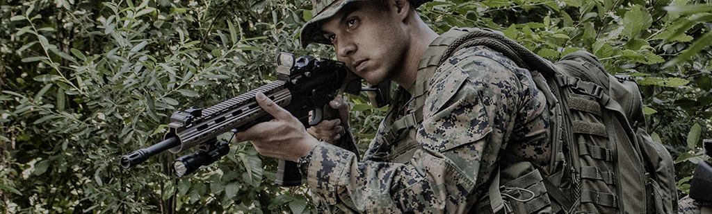 APO header image of soldier in combat